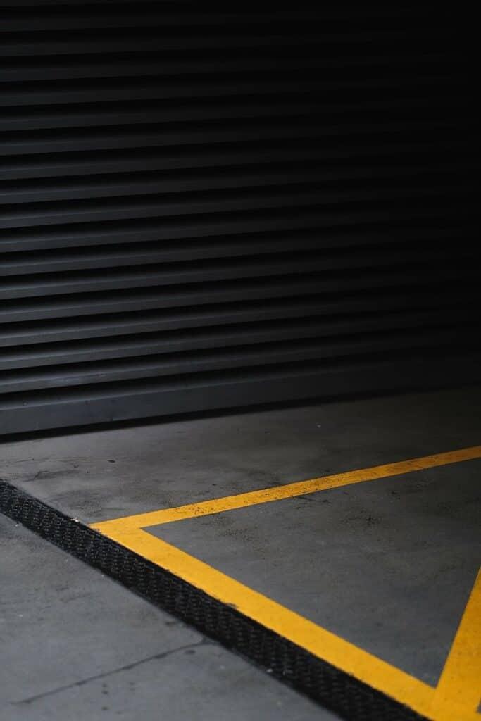 dark asphalt wall Car Park Shutters vs. Car Park Barriers vs. Bollards S&S Shutters